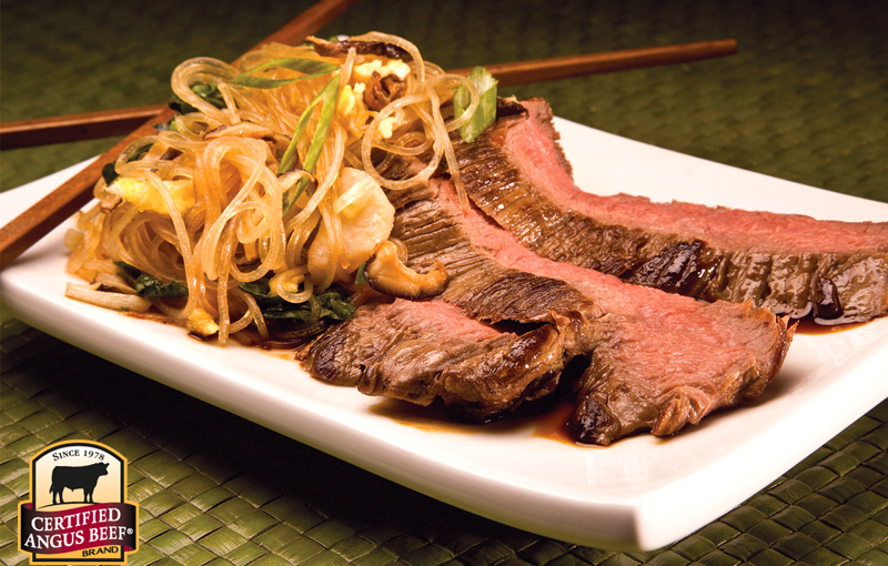 Flank steak with Asian noodles.