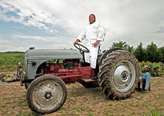 Chef Josh Moore on his tractor by photographer Dan Dry