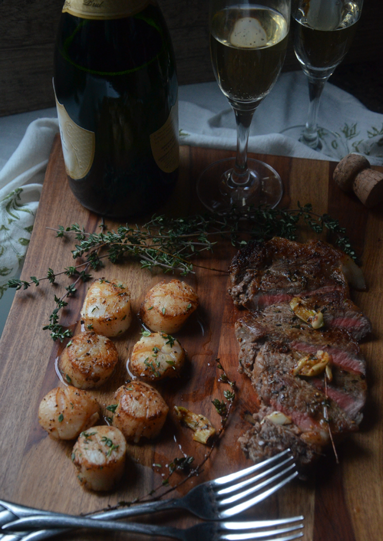Herb & Butter Scallops with Pan-seared Strip Steaks