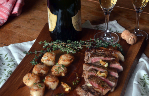 Valentine's Day Surf & Turf: scallops and strip steaks with champagne.