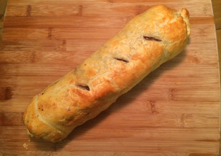 Beef Wellington in golden crust