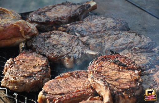 Cowboy steaks prepared on the open range by the chuck wagon cook.