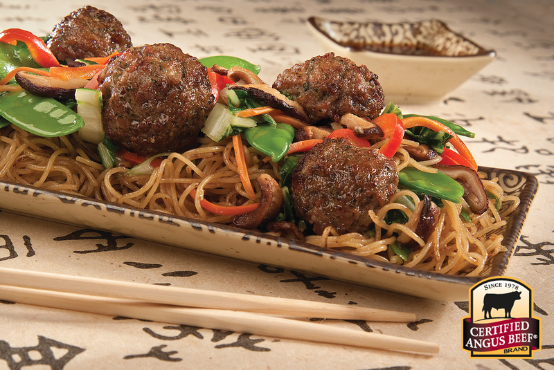 Meatballs and noodles with snow peas.