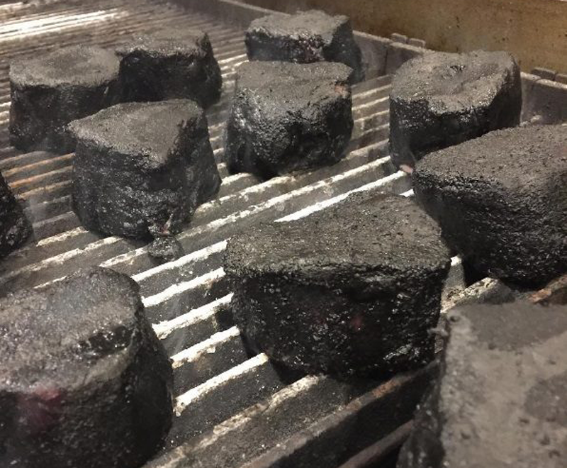 Charcoal powder adds depth to steaks.
