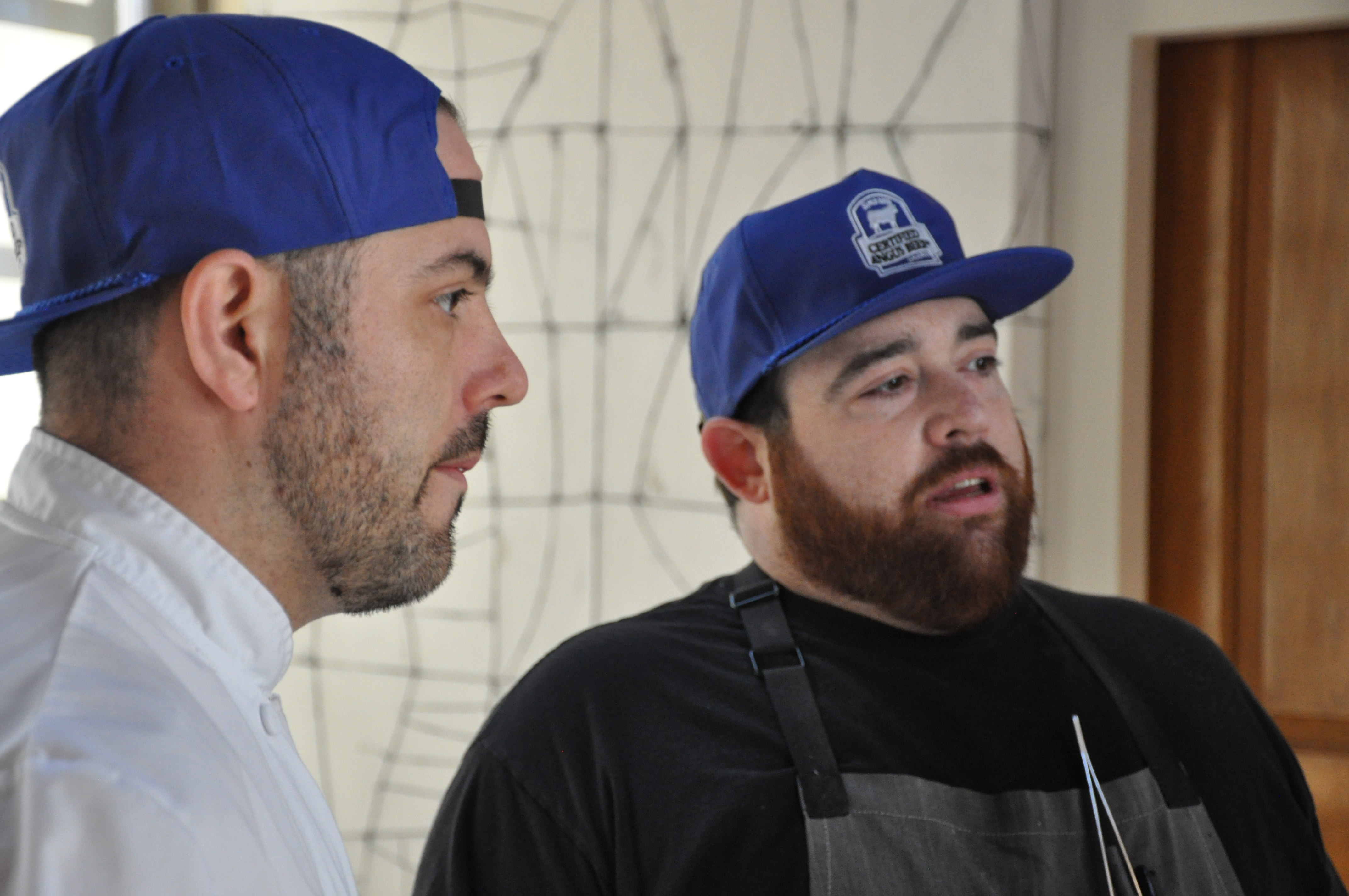 Chefs Mytro and Kocab preparing for a special beef-centric dinner.
